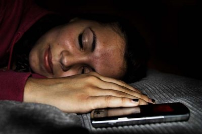Students often choose phones over sleep
