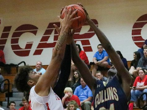 Cougar Basketball mauled by Klen Collins Tigers