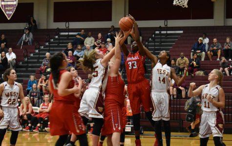 Girl's basketball lasso the Mustangs