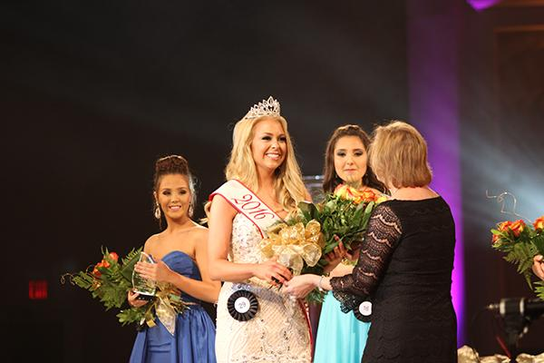Hanna Carroll is crowned the 2015 Miss Tomball winner. She will help crown the next winner soon.