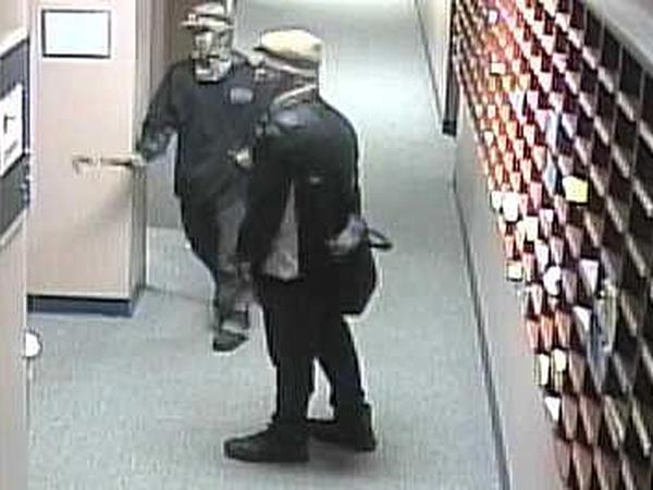 Two people with covered faces did $20,000 in damages to the school on homecoming weekend.