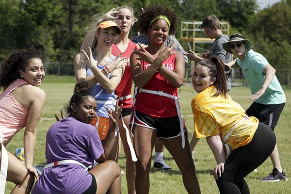 Senior girls pose for a picture during Powder Puff practice