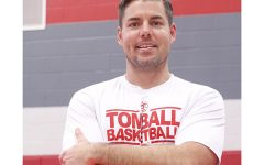 New boy's basketball coach takes over with large expectations.