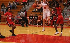 Basketball bashes Waller, runs district record to 4-4