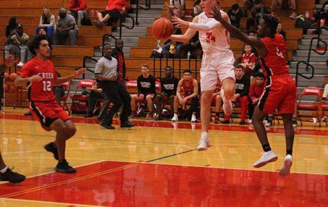 Basketball bashes Waller, runs district record to 4-4