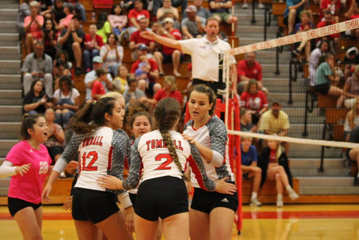 Volleyball team during a game after scoring a point.