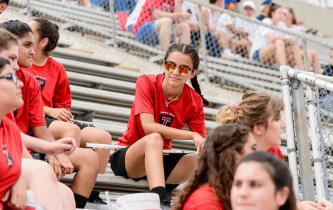 Elise Guerra sitting in the bleachers during band rehearsal.