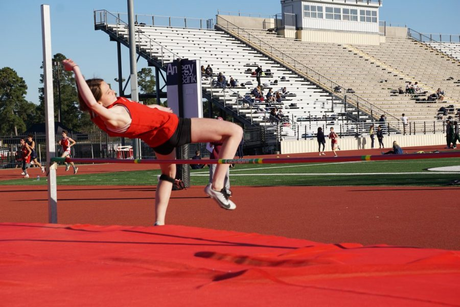 A member of the Tomball track and field team competes in the high jump.