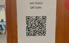 QR Code for Membership Form can be found outside Room 1205.