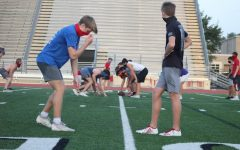 Varsity football team players practice for their upcoming season.