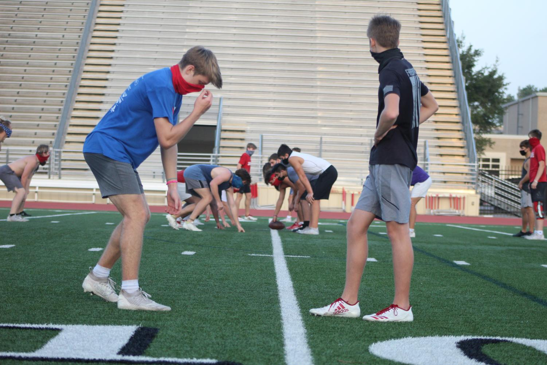Varsity football team players practice for their upcoming season.