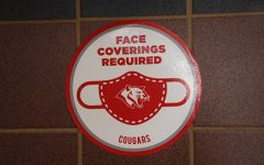 Signs adorn the walls at THS warning students to wear masks and practice social distancing.