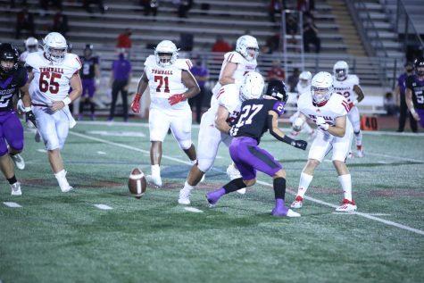 Varsity football team plays against Willis.