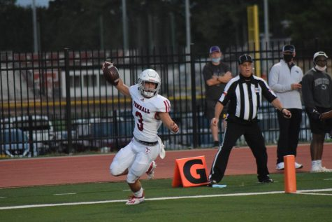 Quarterback Cale Hellums runs into the end zone for a touchdown.