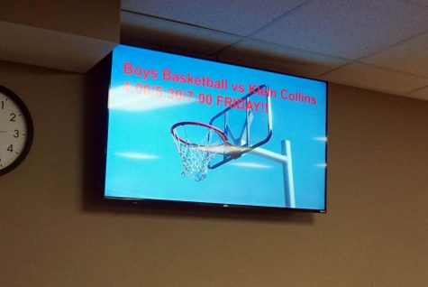 One of the new TVs hangs by the front desk.