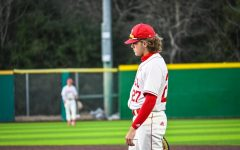 Varsity baseball player Casen Neumann gets ready for the next batter.