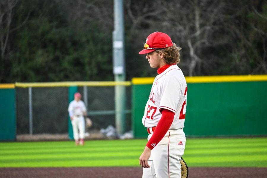 Varsity+baseball+player+Casen+Neumann+gets+ready+for+the+next+batter.+