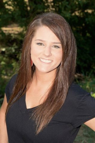 Kelsie Cain joins the Cougar Charms as the assistant director.