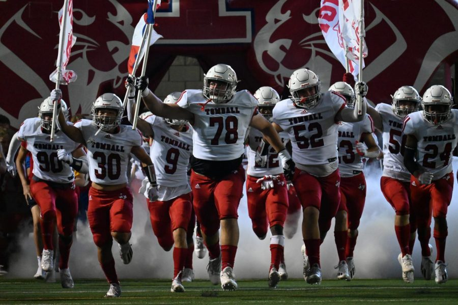 The Cougar Football team runs out of the tunnel to open up the second half against Oak Ridge.
