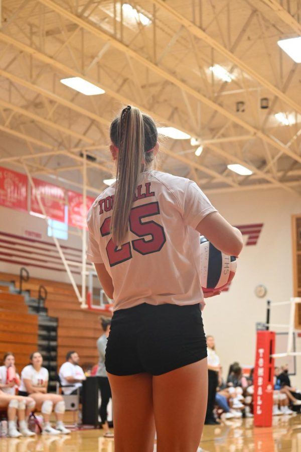The+Cougar+volleyball+team+prepares+to+serve+up+another+win.