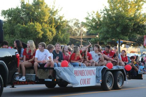 Nominees for the Homecoming Court ride on a float in the Homecoming Parade on Wednesday.